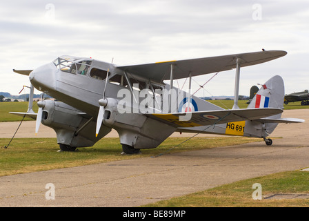 An RAF De Havilland DH89A Dragon Rapide Transport Aircraft HG691 Parked on Apron at Duxford Aerodrome IWM England - Stock Photo