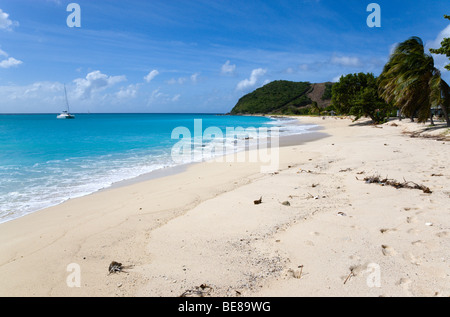 WEST INDIES Caribbean St Vincent & The Grenadines Canouan Island South Glossy Beach in Glossy Bay Waves break on - Stock Photo