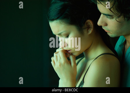 Young couple together, man consoling woman - Stock Photo