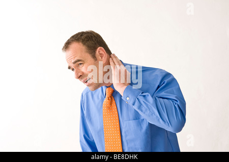 Man wearing tie and shirt, hand on his aching neck - Stock Photo