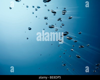 Oxygen bubbles rising to the surface of water - Stock Photo