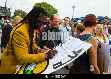 Levi Roots adding line to poem at Abergavenny Food Festival Monmouthshire South Wales UK - Stock Photo