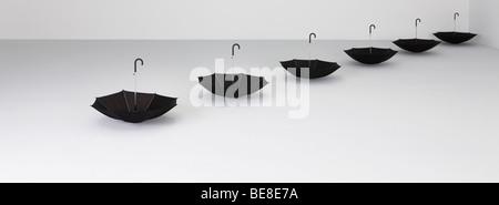 Upside down umbrellas in a row - Stock Photo
