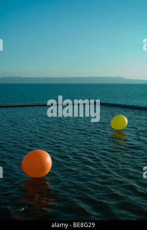 Two balloons on water - Stock Photo