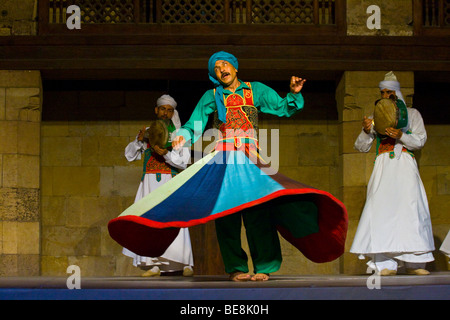 Whirling Dervish from El Tannoura Troupe in Cairo Egypt - Stock Photo