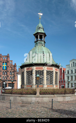 Baroque Wasserkunst, water tower in the marketplace of the Hanseatic city of Wismar, UNESCO World Heritage Site, - Stock Photo