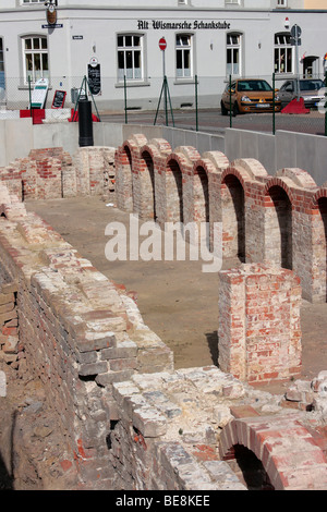 Archaeological excavation of an old brick building in the Hanseatic city of Wismar, UNESCO World Heritage Site, - Stock Photo