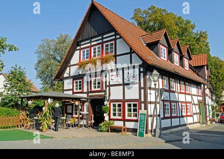 Cafe, restaurant, half-timbered house, historic town centre, Luegde, Bad Pyrmont, Teutoburg Forest Park, North Rhine - Stock Photo