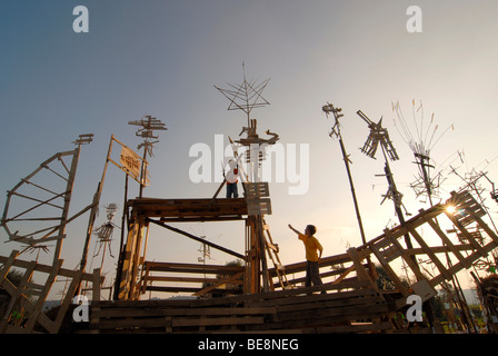 Wooden sculptures and installation in the form of birds and a large pirate ship on the Elbwiese meadow for the Radebeul - Stock Photo