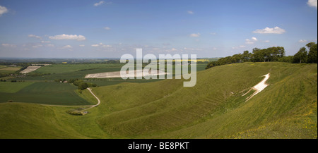 Panoramic view over the rural north wiltshire countryside and the Cherhill White Horse from Cherhill Down near Calne - Stock Photo