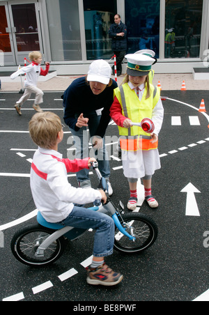 Children learning traffic rules at the 63th IAA International Motor Show Frankfurt/Germany - Stock Photo