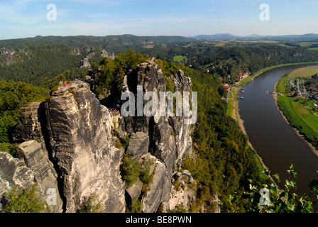 View of the Saxon Switzerland National Park with the Elbe River and the spa town of Rathen as seen from the Bastei, - Stock Photo