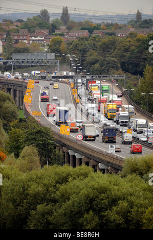 ELEVATED SECTION OF THE M6 MOTORWAY NEAR BIRMINGHAM,UK,WITH RESIDENTIAL HOUSING LOOKING OVER IT. - Stock Photo