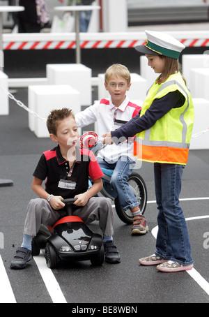 Children learning traffic rules at the 63th IAA International Motor Show Frankfurt/Germany - Stock Photo