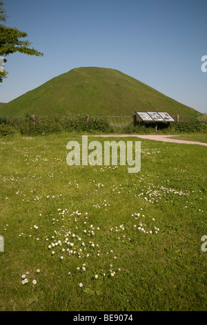 Silbury Hill ancient mound near Avebury in Wiltshire on a sunny summer day - Stock Photo