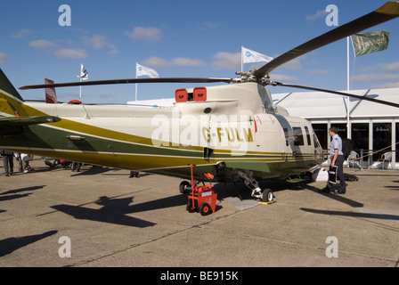 Sikorsky S-76C Helicopter Air Harrods Ltd G-FULM at Helitech Trade Show Duxford Aerodrome England United Kingdom - Stock Photo
