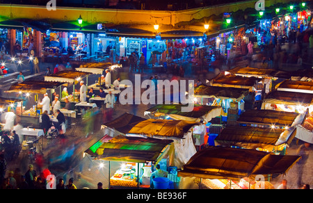 Morocco, Marrakesh,. Food stalls and shopping at Djemaa el-Fna Square - Stock Photo