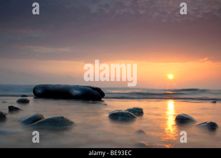 Sunrise on Lake Constance with a piece of flotsam made of wood, Konstanz, Baden-Wuerttemberg, Germany, Europe - Stock Photo