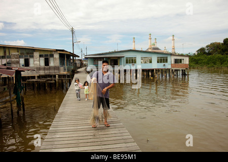 Fishermen in a village built on stilts, Kampong Ayer, Water Village, a district of the capital city, Bandar Seri - Stock Photo