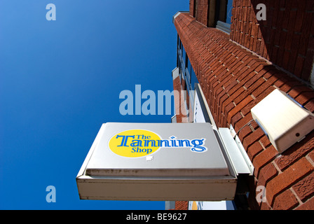sign for a branch of the tanning shop, in twickenham, middlesex, england - Stock Photo