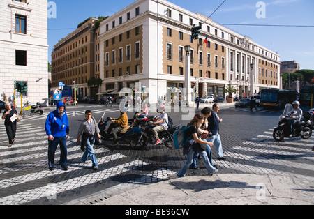 ITALY Rome Lazio Pedestrians crossing with people and traffic on the Via della Conciliazione leading to Vatican - Stock Photo