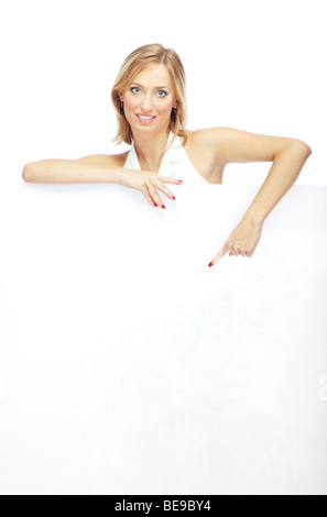Smiling lady pointing to the billboard on a white background - Stock Photo