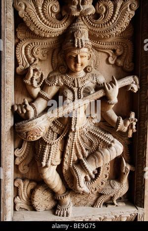 Wood carving of Indian God, Shiva - Stock Photo