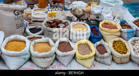 indian market stall with sacks of indian spices and dried produce - Stock Photo