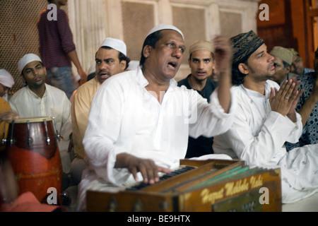 Qawwalli singers at the Sufi shrine Amir Khusro Dehlavi  buried at the Hazrat Nizamuddin Awlia Shrine, Delhi, India - Stock Photo