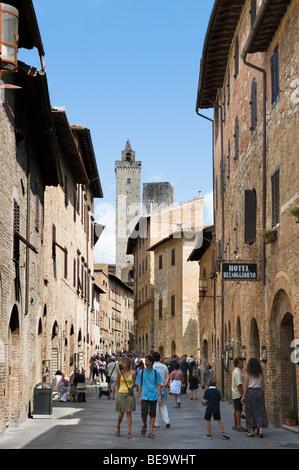 Via San Giovanni looking towards the Torre Grossa, San Gimignano, Tuscany, Italy - Stock Photo