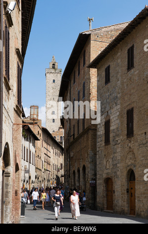 Via San Giovanni looking towards the Torre Grossa, San Gimignano, Tuscany, Italy - Stock Photo