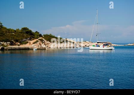 Croatia; Hrvartska; Kroatien, Vis, Sail charter boat anchored for lunch in beautiful Croatian bay - Stock Photo