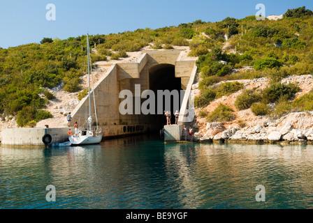 Croatia; Hrvartska; Kroatien, Vis, Sail charter boat tied up along side WWII submarine pen - Stock Photo