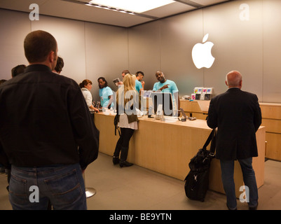 customers in checkout queue at Apple Store, Regent Street, London, England, UK - Stock Photo