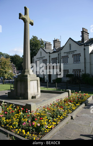 Village of Disley, England. Disley war memorial with the 19th century Rams Head public house in the background. - Stock Photo