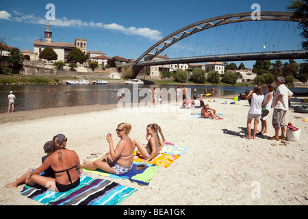 People sunbathing on the river beach on the river Lot, Castelmoron, Aquitaine, France - Stock Photo