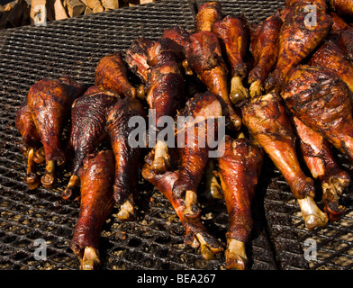 Turkey Legs on the barbeque at a food stand at the Los Angeles County Fair (2009) Pomona Fairplex Pomona, California, - Stock Photo