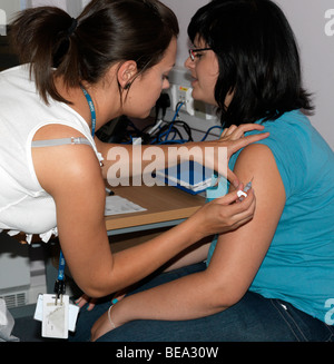 Teenager having an HPV injection to protect against Cervical Cancer - Stock Photo