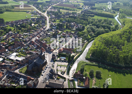 Urbanisation at the border of agricultural area with forest from the air, Belgium - Stock Photo