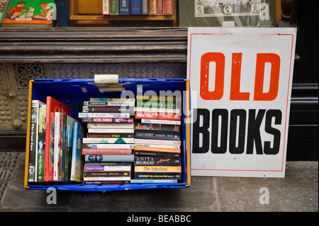Old books of sale in shopping arcade Cardiff South Wales UK - Stock Photo