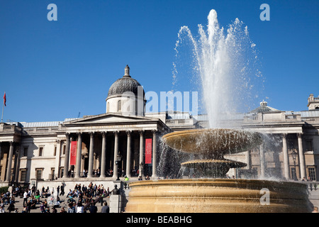 Trafalgar Square fountains and the National Gallery in London - Stock Photo