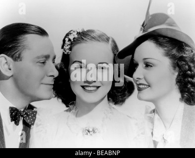 MAD ABOUT MUSIC - 1938 Universal film with from l: Herbert Marshall, Deanna Durbin and Gail Patrick - Stock Photo
