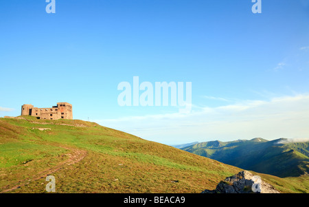 Summer mountain view with fortress - observatory ruins on Pip Ivan mountain top (Chornogora Ridge, Carpathian, Ukraine) - Stock Photo