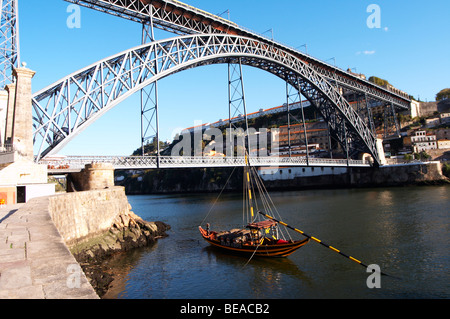 Dom Luis I bridge seen from Cais da Ribeira barco rabelo shipping boat porto portugal - Stock Photo