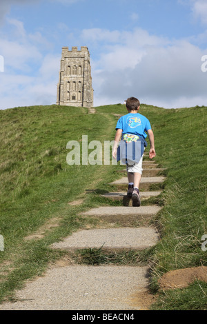 Glastonbury Tor Somerset young boy climbs to St Michaels Tower - Stock Photo