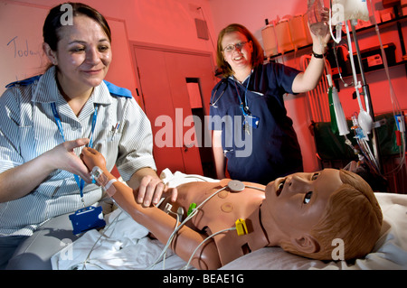 Nurse and staff nurse with a HPS, human interactive dummy at Bristol Medical Simulation Center. UK - Stock Photo