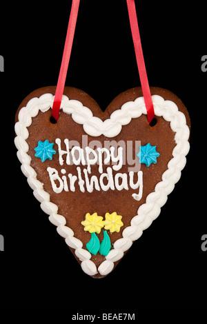 A lebkuchen with Happy Birthday written on it - Stock Photo