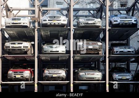 Cars in a parking lift, Manhattan, New York City, NY, USA - Stock Photo