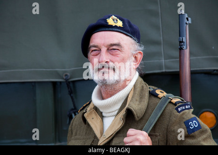 1940 Wartime army man. Bearded British Soldier re-enactor in Military Uniform with Lee Enfield Rifle, Southport, - Stock Photo