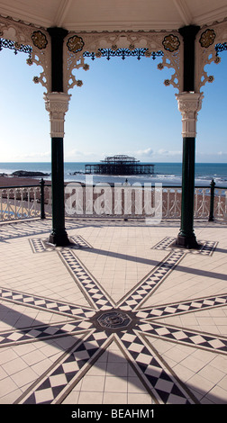 The restored Victorian bandstand overlooking Brighton beach and the remains of the West Pier. Brighton, England - Stock Photo
